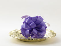 Purple ribbon bows Stock Images