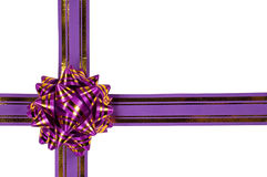 Purple ribbon and a gift bow Stock Image