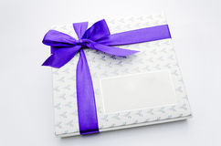 Purple ribbon gift box. Printed over a purple ribbon gift box Royalty Free Stock Photo