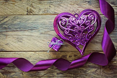 Purple ribbon, heart and gift box Stock Images