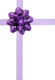 Purple ribbon over white paper Royalty Free Stock Image