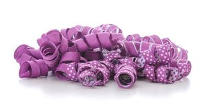 Purple ribbon pile. Pile of curly purple ribbon isolated on white background Royalty Free Stock Photography