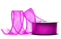 Purple ribbon on spool Stock Photos