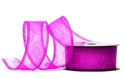 Purple ribbon on spool Stock Photos