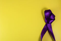 Purple ribbon on a yellow background in the style of pop art Royalty Free Stock Photos