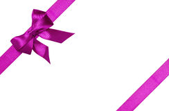 Purple ribbons with bow with tails Stock Photography