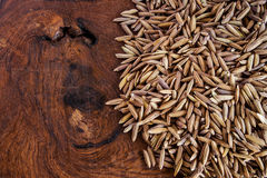 Purple rice seed on wood Royalty Free Stock Image