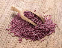 Purple rice on wooden background Stock Photography