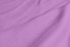 Purple rippled fabric Royalty Free Stock Images