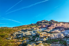 Purple rocks in Sardinian rocky coast Stock Images
