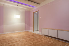Purple room with neon lights Stock Photography