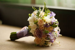 Purple rose bouquet for the bride Royalty Free Stock Images