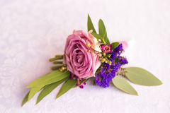 Purple rose boutonniere for the groom. Vintage Stock Photo