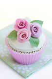 Purple rose cupcake Stock Photos