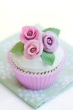 Purple rose cupcake. Cupcake decorated with purple sugar roses Stock Photos