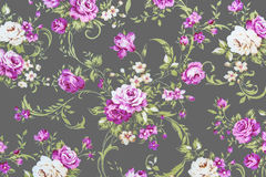Purple rose on gray fabric Background, Fragment of colorful retr Royalty Free Stock Photo