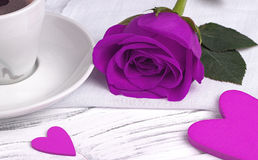 Purple rose and heart shape on white wood background, valentine`s day concept, love symbol. Stock Photo