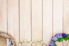 Purple roses hat on wooden background. Top view. Stock Images