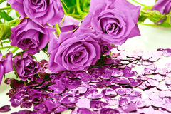 Purple roses and hearts. Purple roses bouquet and heart confetti royalty free stock photography