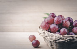 Purple round grapes on old wooden table , vintage Stock Images