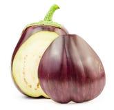 Purple round and half raw eggplant Royalty Free Stock Photos