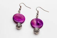 Purple rounded earrings Royalty Free Stock Photos