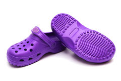 Purple rubber shoes Stock Images