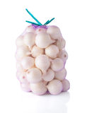 Purple Sac Full With White Onions Stock Image