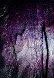 Purple Sand. A purple grainy texture that ripples and dips along the grooves Royalty Free Stock Photos