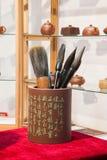 Purple sand brush pen holder Royalty Free Stock Photos