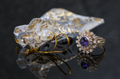 Purple sapphire ring with diamond chips and gift bag. Purple ring is vintage and has several diamonds surrounding the stone. The ring setting is gold and there Stock Image