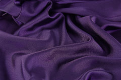 Purple satin. A background of purple satin for that royal look Stock Images