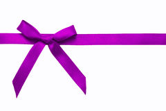 Purple satin bow on a satin ribbon. Stock Photo