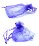 Purple Satin Drawstring Gift Bag. Two angles of a transparent purple satin drawstring gift bag isolated on white background Royalty Free Stock Photos