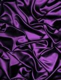 Purple satin fabric background Stock Images