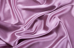 Purple satin or silk background Royalty Free Stock Image