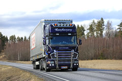 Purple Scania Semi Cargo Transport along Highway royalty free stock images