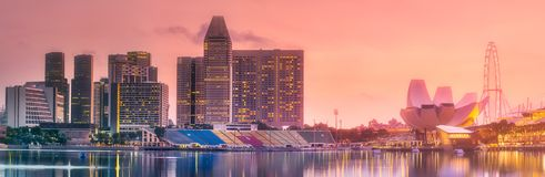 Business district and Marina bay in Singapore. Purple scenic sunset and skyline of downtown district and Marina bay, Singapore Royalty Free Stock Image