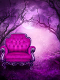Purple Seat. A purple plush chair in the middle of a fantasy forest background Royalty Free Stock Image