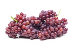 Purple seedless grapes. A big bunch of purple seedless grapes isolated Stock Photo