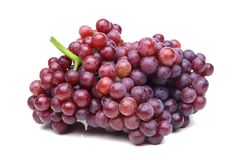 Purple seedless grapes. Isolated on white Stock Photos