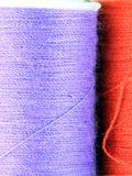 Purple sewing thread Stock Images