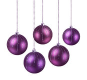 Purple shaded Christmas balls. Purple shaded modern Christmas balls hanging white background stock photos