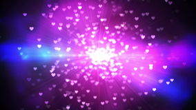 Purple shimmering hearts on black background stock video