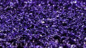 Purple shiny glitter seamless loop abstract texture close up macro background