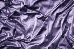 Purple shiny silk fabric texture. Graphics designs royalty free stock image