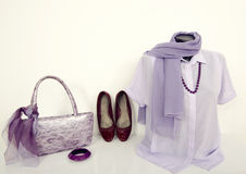Purple shirt on mannequin with matching accessories. Summer blouse on tailor's dummy with purse, shoes, scarf and jewellery Royalty Free Stock Photography