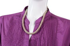 Purple shirt with silver necklace. Stock Image