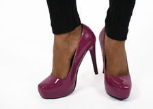 Purple shoes on legs stock images
