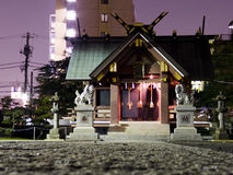 Purple Shrine. Picture of Japanese shrine in Tokyo taken at night, which is why the sky appears in a strong and vibrant purple royalty free stock photo